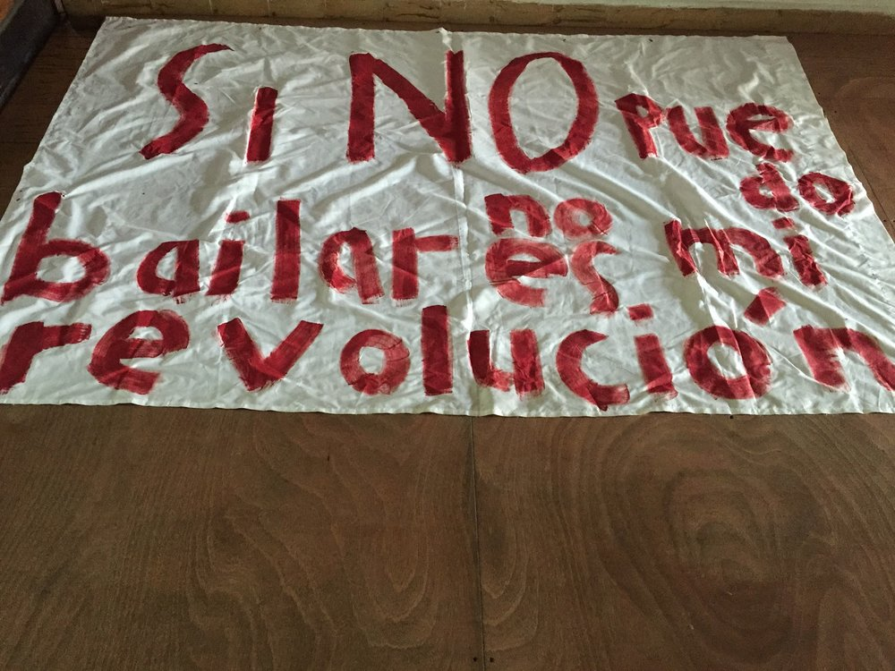 "marzo 2017. en preparación al #ParodeMujeresPR autogestión y documentación en PISO Calle Estrella. Banner reads ""Si no puedo bailar no es mi revolución"" which stands for: If I cannot dance it is not my revolution. If it is not feminist and intersectional it is not my revolution"