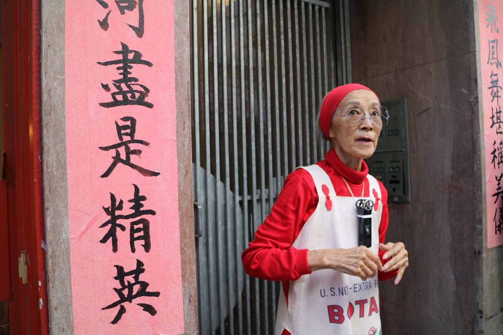 Dorothy Quock sharing memories in an alleyway taken by Mei Lum