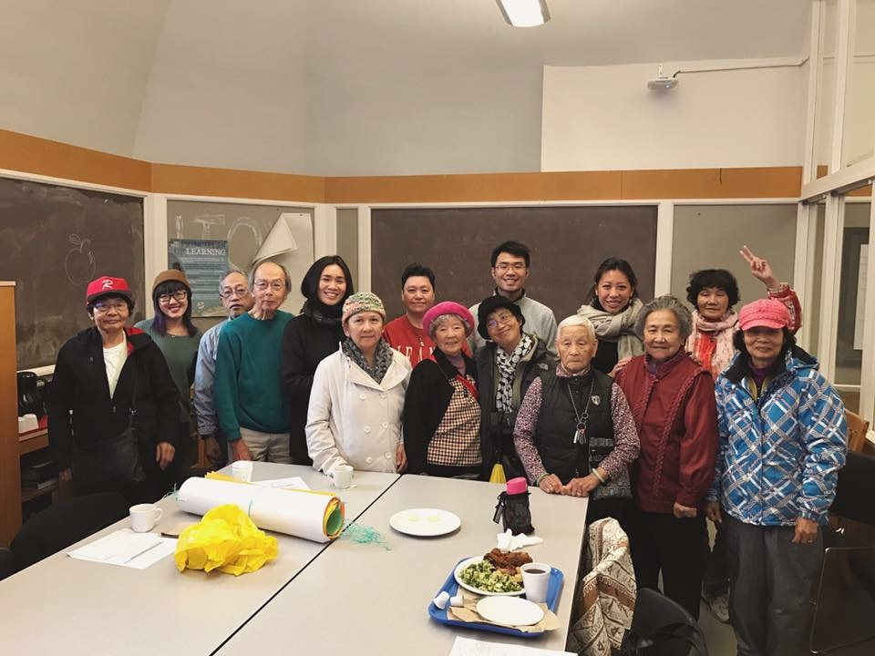 Chinatown Concern Group volunteers after their weekly meeting at the Carnegie Center taken by Vipul Chopra