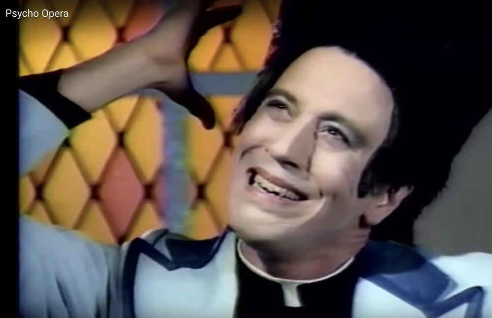 John Fleck, video still from Psycho Opera  Wallenboyd Theater, LA 1989, photo via  YouTube