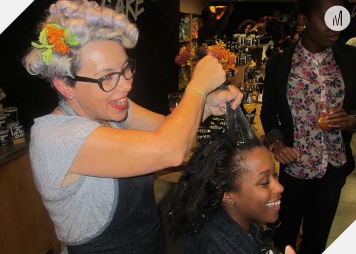 Wendy Millington applying a hair treatment