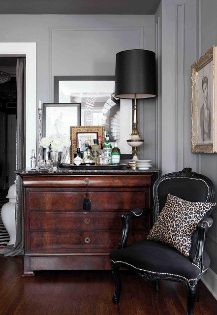 Proof that antiques don't have to equal grandma's house (no offense to grandma or her house).  But seriously, look how chic and glamorous this space looks.