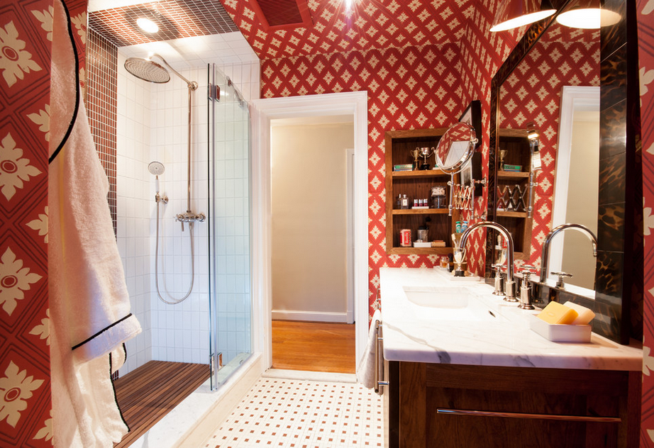 Most designers have a love-hate relationship with red. It can be overpowering. I tend to fall on the love side of red more often and I kind of really like this bathroom. I don't think I would have done the wallpaper on the ceiling, but hey. It's still a cool space. Take a look at the whole bath transformation if you are intrigued.