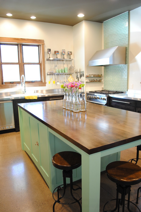 Notice the pops of lemon yellow in the kitchen accessories in this mint and wood kitchen--so cheerful!