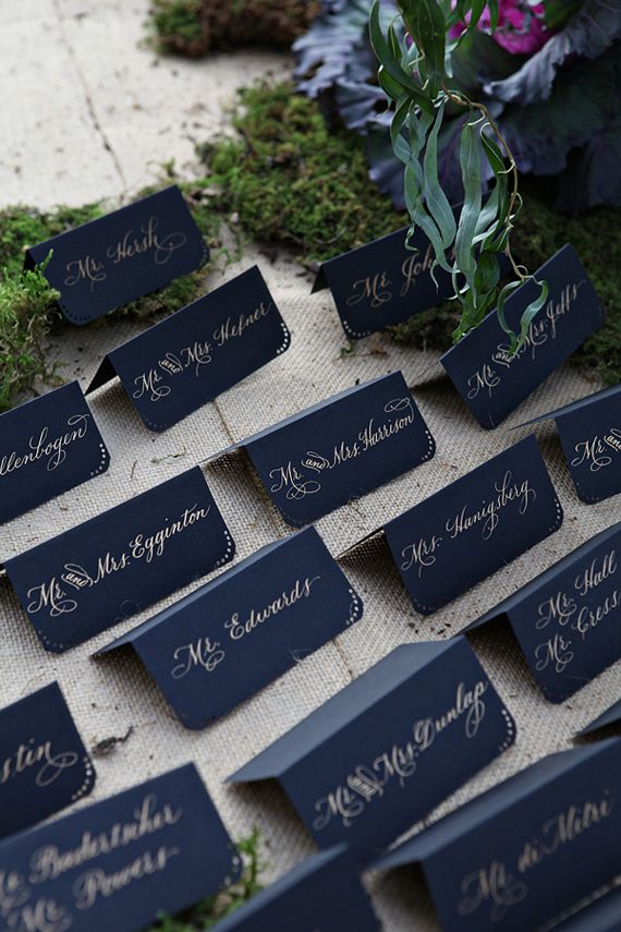 Opt for dark card stock over light and write out guests' names in a gold gel pen.  Embellish with simple dot patterns and rounded corner for an added touch.  Source