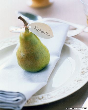 Fruits and veggies make great place card stands.  Grab seasonal favorites at the farmer's market or local grocery.  Pumpkins (I prefer white) are a great choice as well, but I love the green these pears bring to a table.   Source