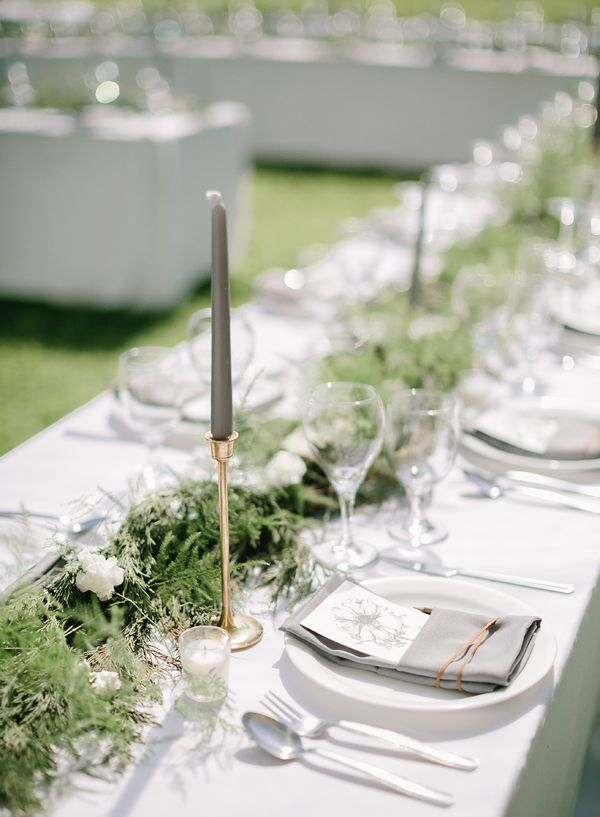 Switch up your normal table decor with changing your white tapers to gray ones.  This has bee a favorite I've seen lately.  Image via  Southern Weddings