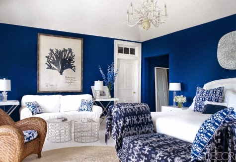 Here they went with a bold blue but kept the room feeling bright by reflecting the natural light off of the white furniture, floor, and ceiling.