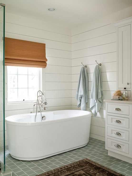 White ship lap in a bathroom designed by Lauren Liess Interiors via DecorPad.