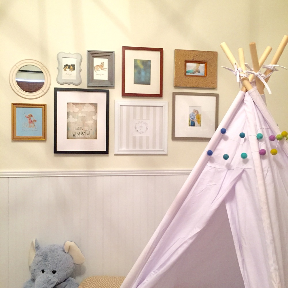 child room with tee pee gallery wall