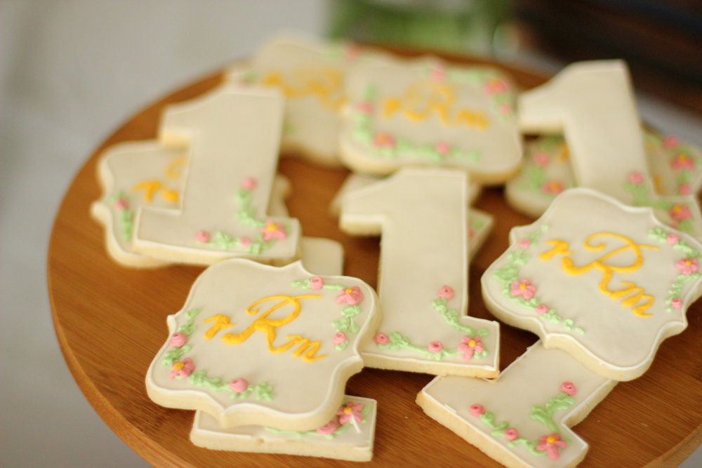 floral first birthday monogram sugar cookies