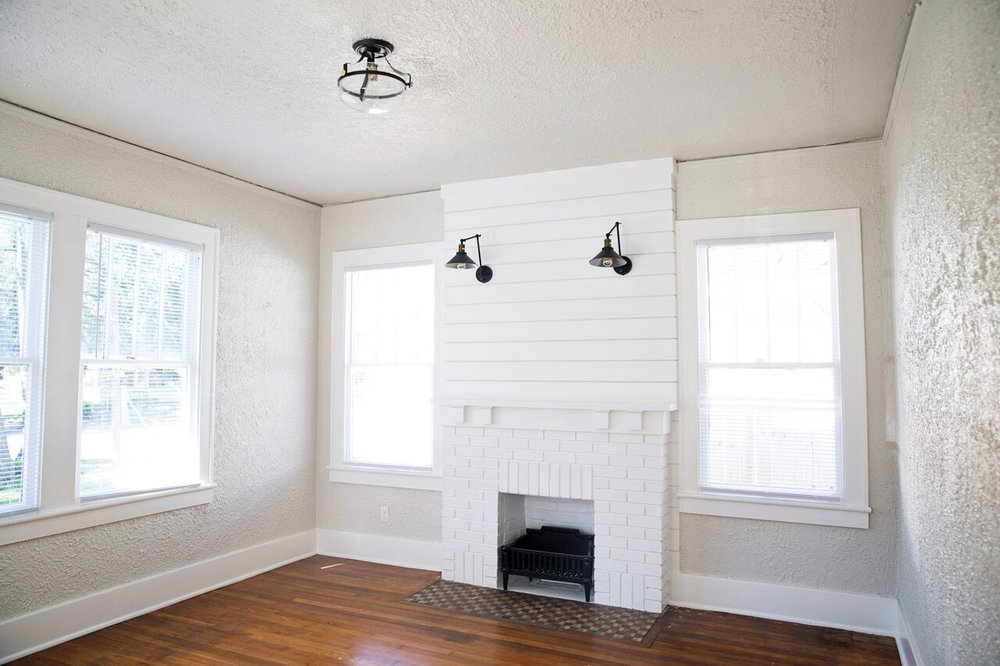 behr silver drop shiplap fireplace living room after.jpeg