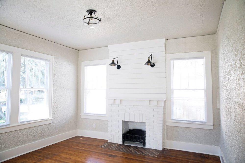 behr silver drop shiplap fireplace living room after.jpeg