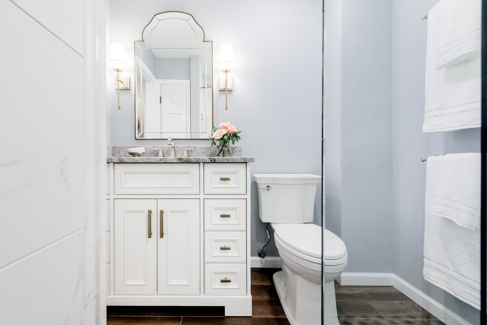 light blue bathroom with white vanity.jpg