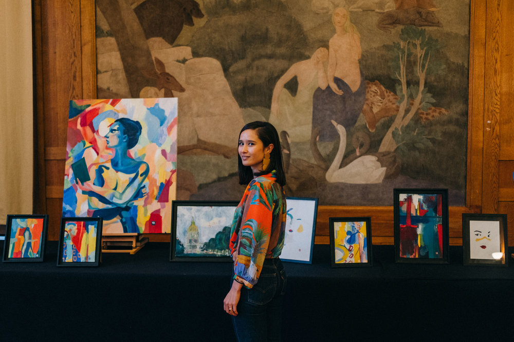 """Portrait of Yaya Chang in front of her paintings at the opening of """"3 Americans in Paris"""", Paris, March 2019.  Photo credit to Alina Sepp  http://alinasepp.com/"""