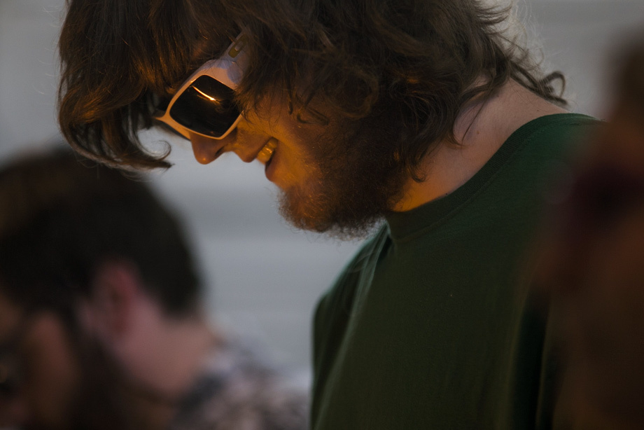 Jamie Krogh of Seattle wears sunglasses to look at the flame during a class at The Boro School, a new glassmaking school concentrating on borosilicate glass, Tuesday April 1, 2014.