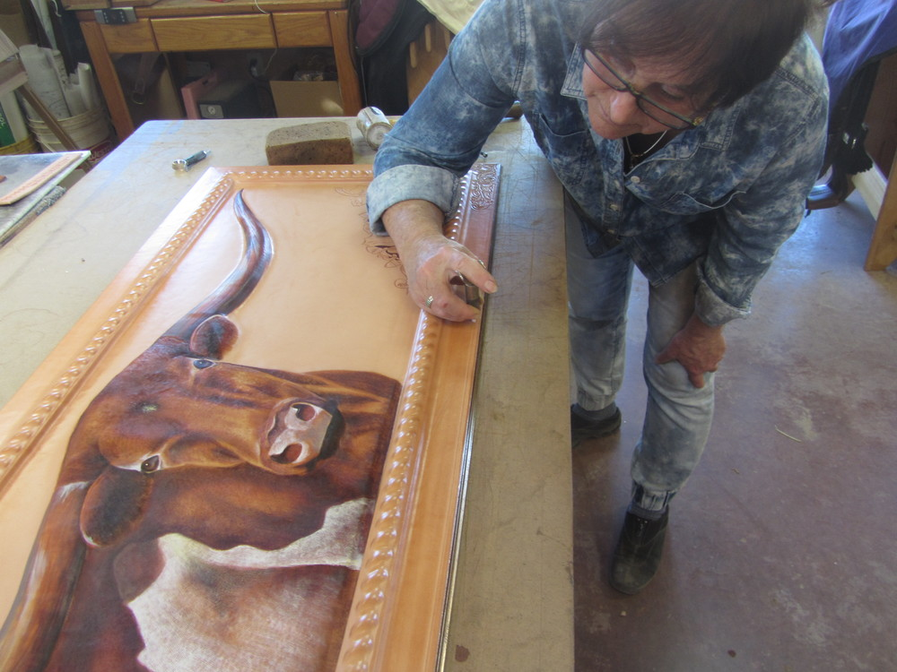 "Carving the frame of ""The Boss"""