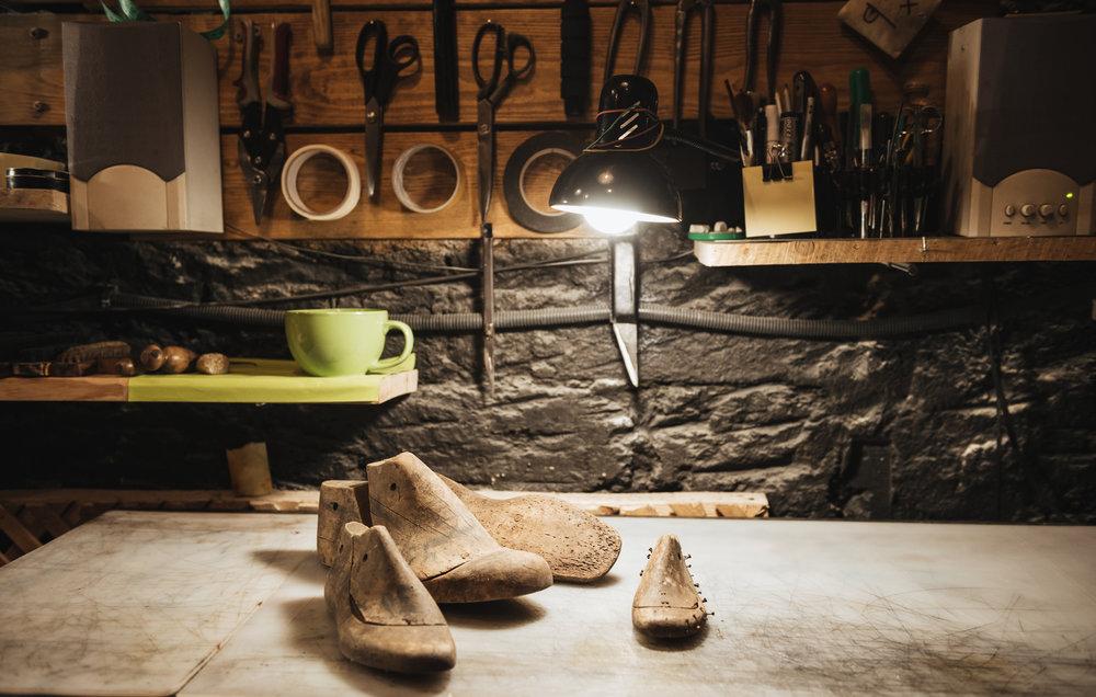 shoes-on-table-at-footwear-workshop-PFXF4LT.jpg