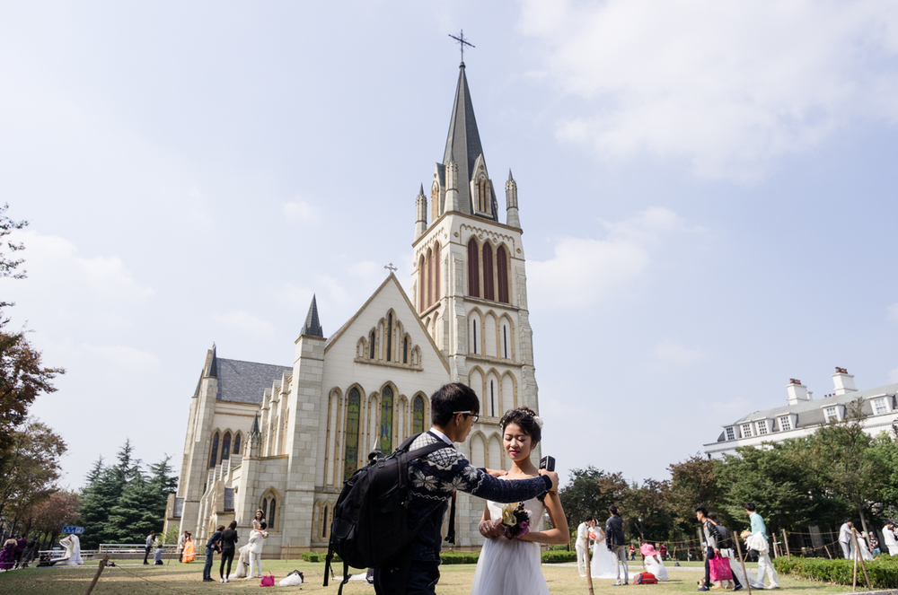 Bridal photography in front of Thames Town's church. Thames Town is a faux-English village in Songjiang, a suburb of Shanghai.