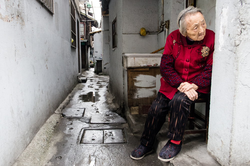Old lady in a dilapidated part of Shanghai.