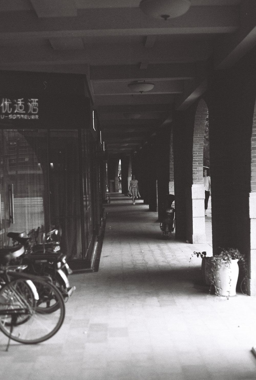 The long brick walkway running around the edge of the stadium.