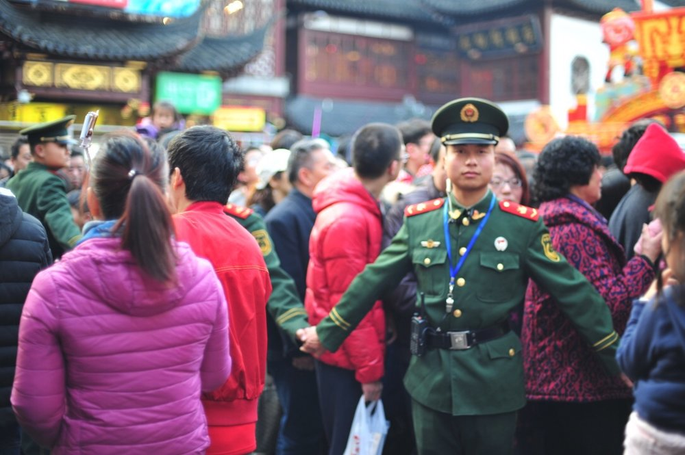The PLC (People's Liberation Army) keep the crowds safe from harm.