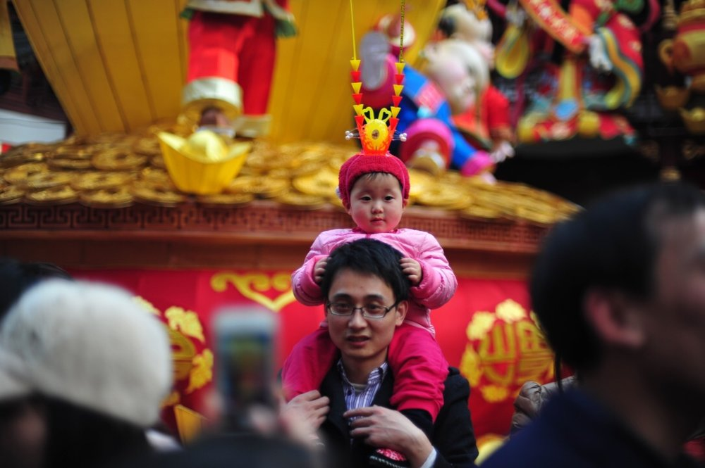 Monkey King baby enjoys a photo opp with dad