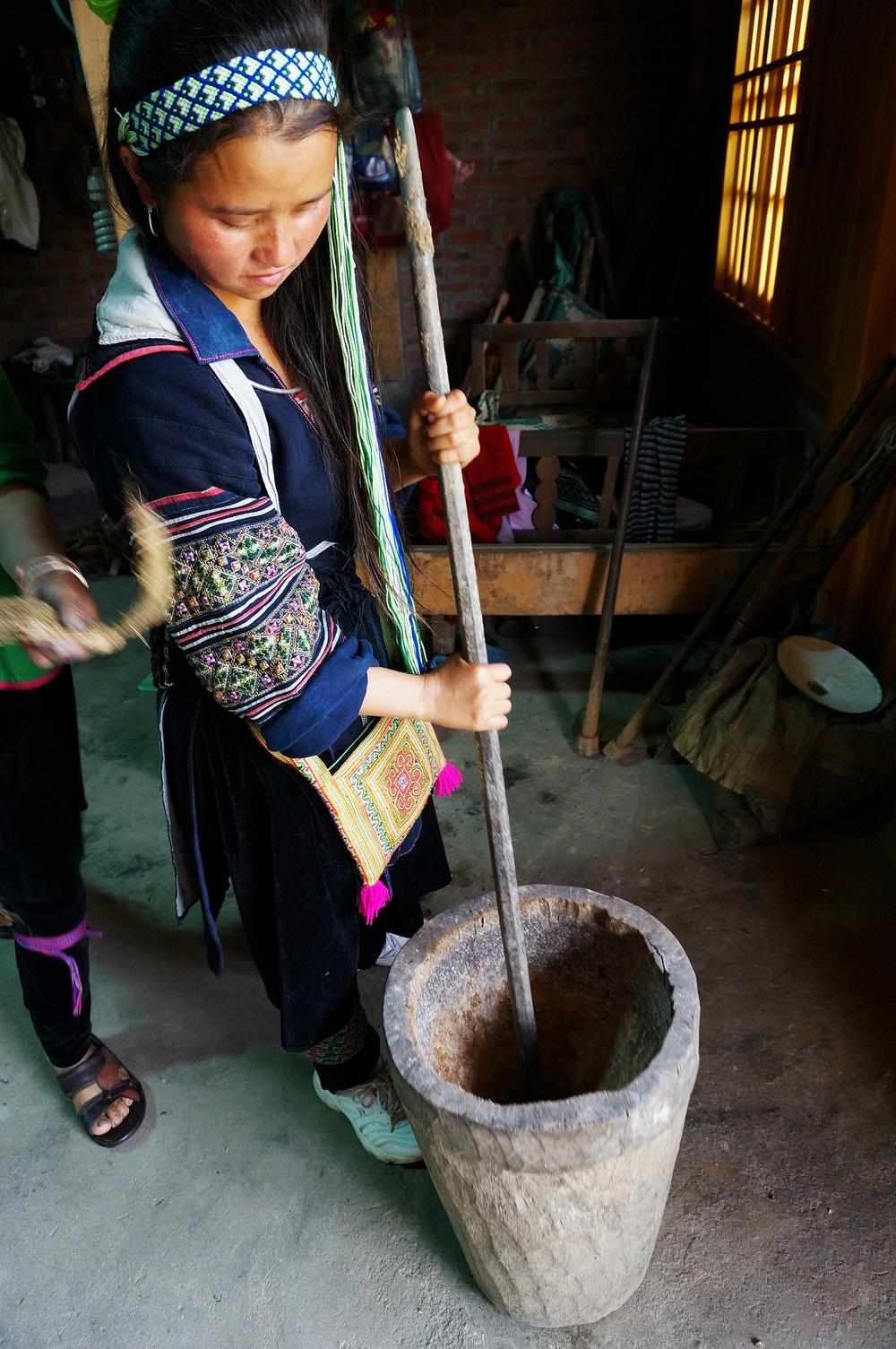 Shosho crushing the hemp stalks by hand