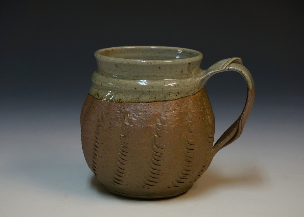 New mug with a darker clay body, with the same clear glaze inside and overlapping.