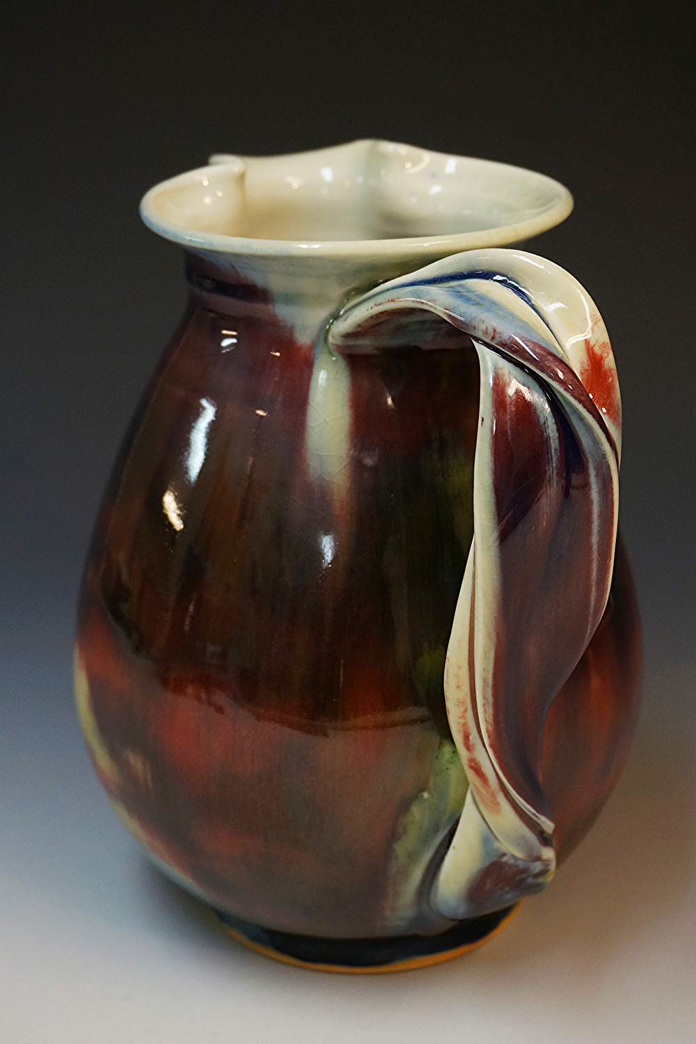 I've also applied this new handle design, with some beautiful results, to my large pitchers. The copper red glazes flow beautifully along it's line, creating truly unique and stunning effects.