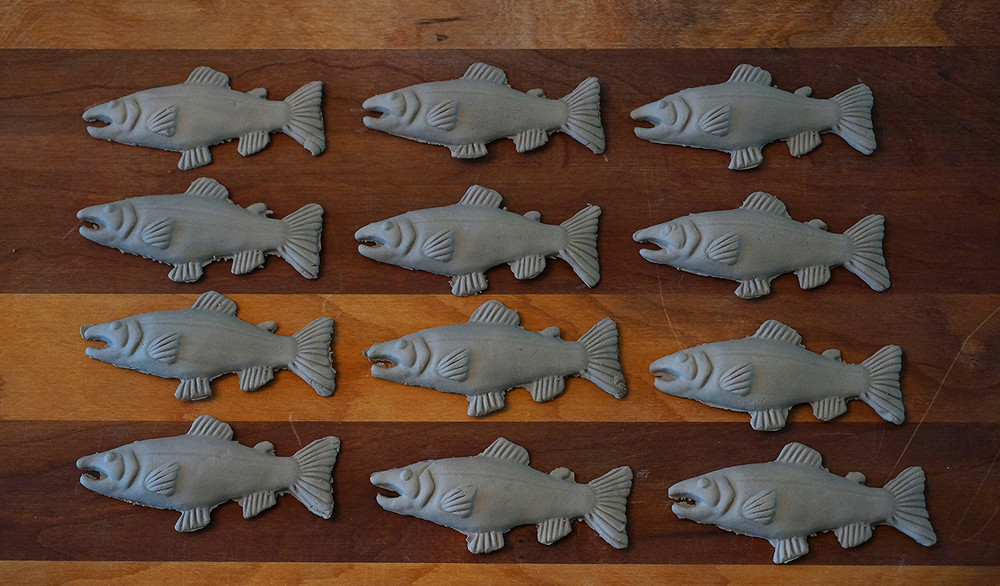 After carving the original fish design by hand, I created a plaster mold to allow me to easily make multiple fish.
