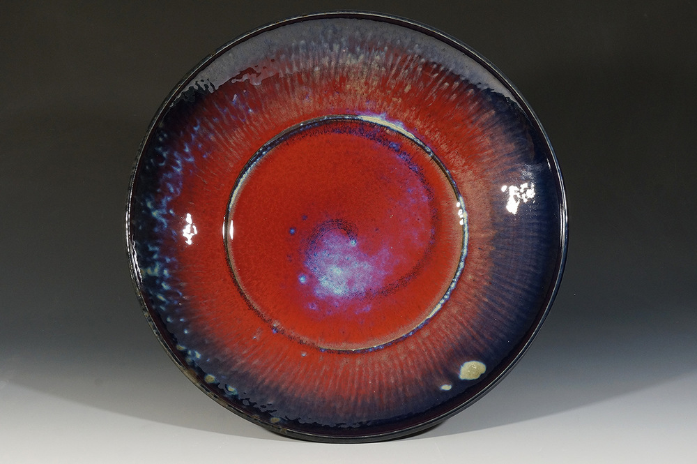 Large Copper Red Plate by Joseph