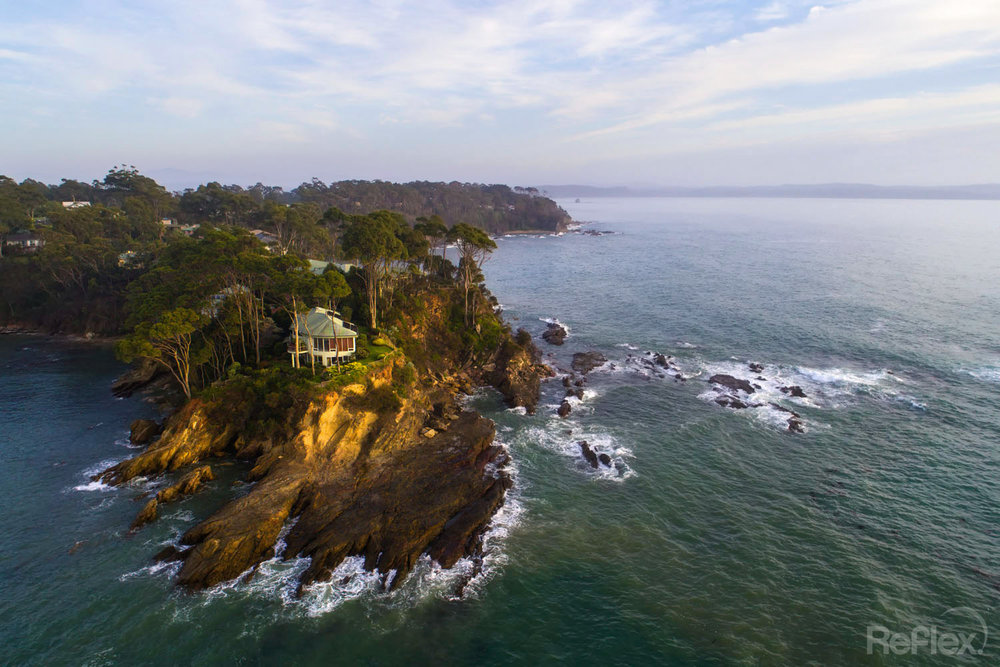 Sunrise drone/UAV shot of a cliffside property on the south coast of NSW