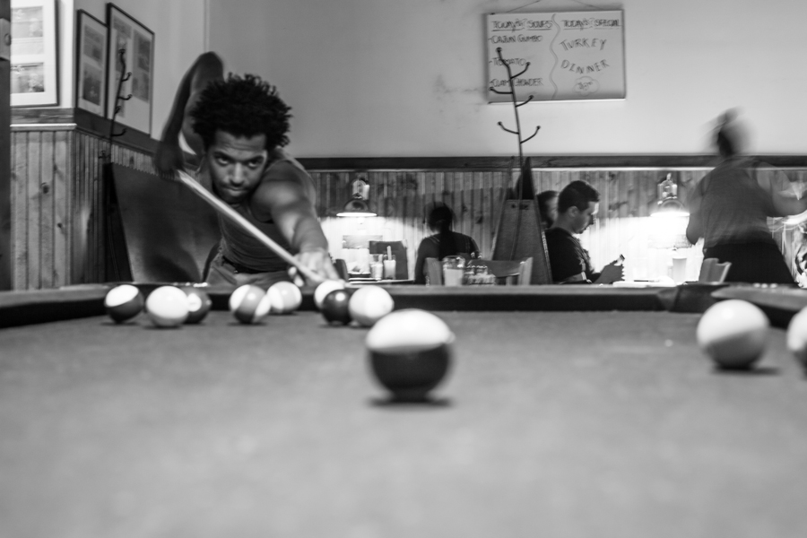 mike's friend arji- playing pool one night whilst eating chicken waffles and drinking beers