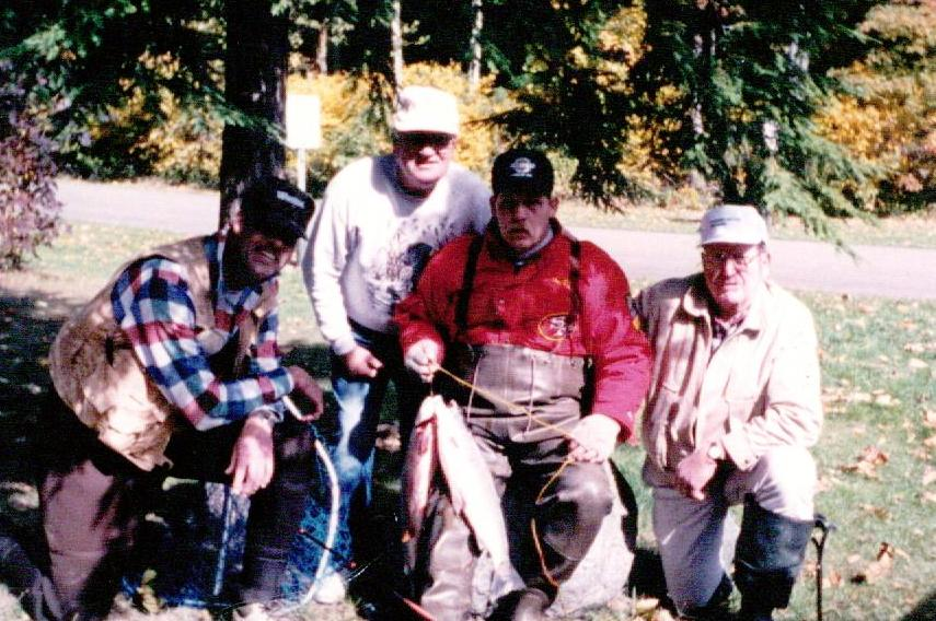 Craig (far left) with some of his 'fishing family'