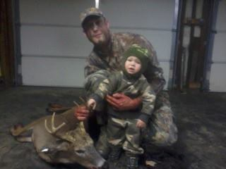 Hunting Dad Justin with his buck and son Hunter
