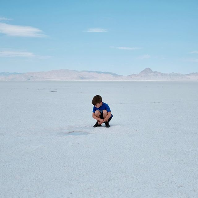 Leo's fascinated with a puddle lurking amongst the salt flats