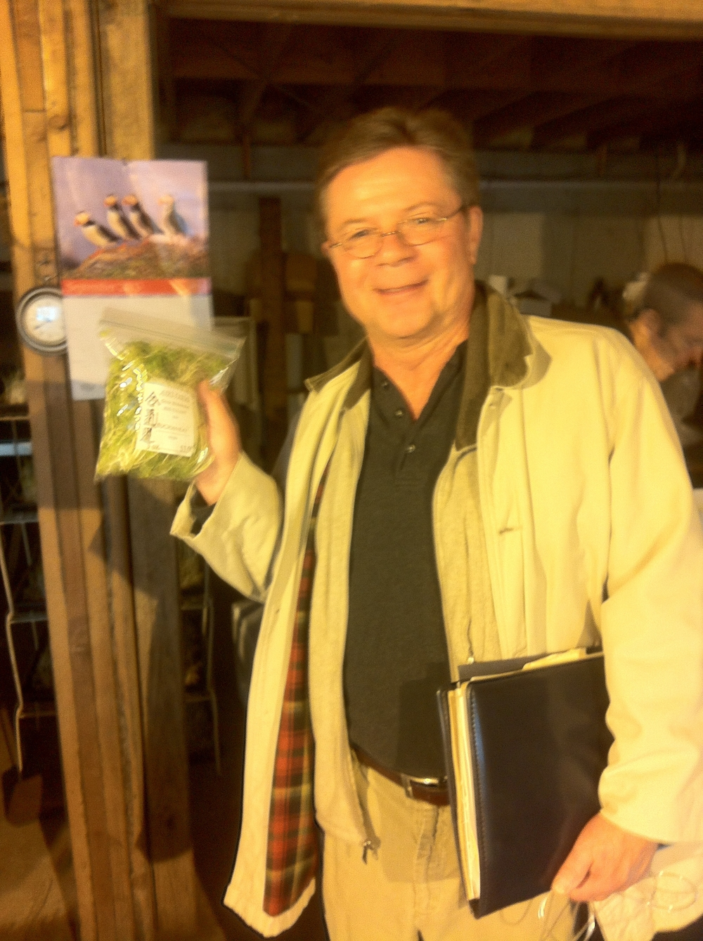Bob treated us to samples; Paul Jakoboski of St. Francis House is eager to try the sprouted seedlings.
