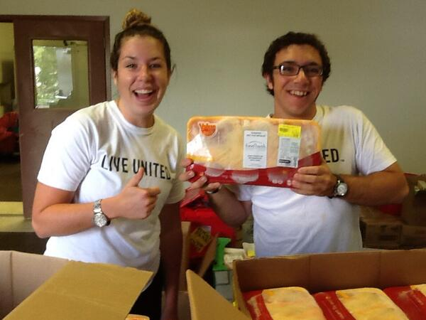 Sarah and her fellow VISTA Joe help out at the Gemma E. Moran United Way/Labor Food Center