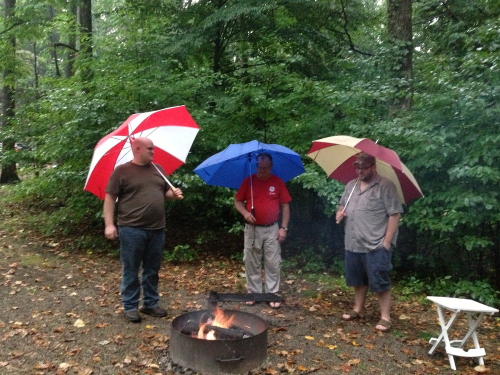 My brother-in-law, father-in-law, and I were unwilling to let a good fire go to waste, rain or no rain.