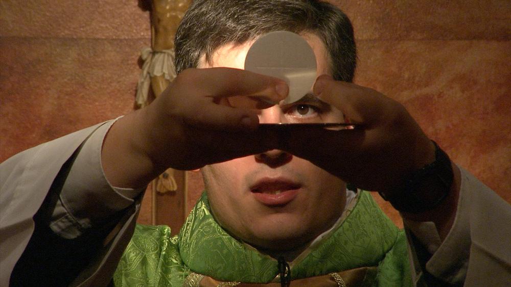 Priest holding eucharist