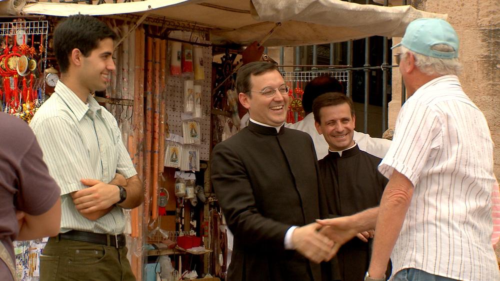 priests-with-old-man.jpg