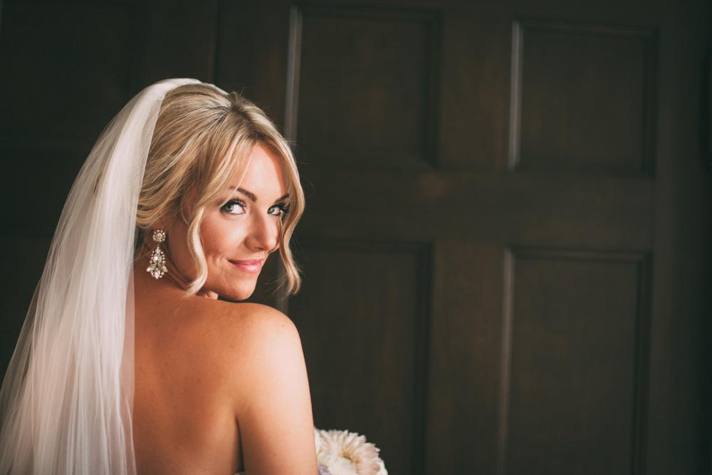 Bridal portrait - bride in front of wooden doors