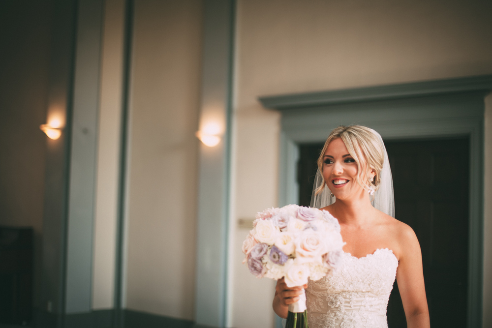 Portrait of a Smiling Bride with Her Bouquet