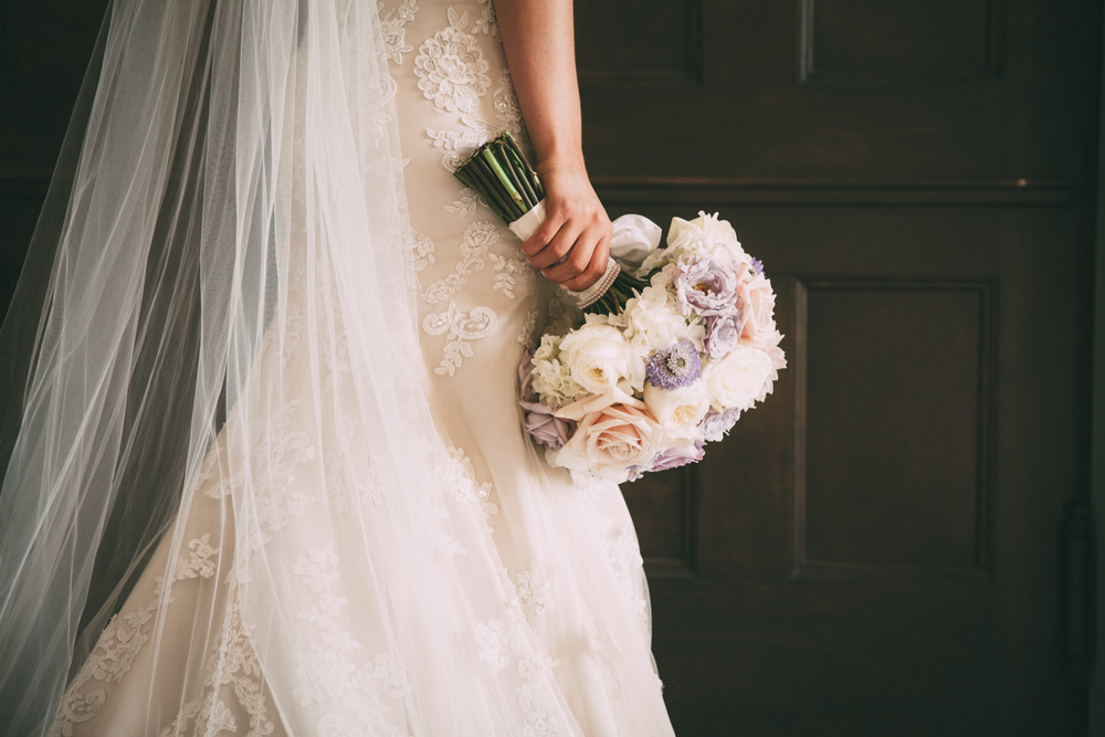 Bride's wedding dress and bouquet
