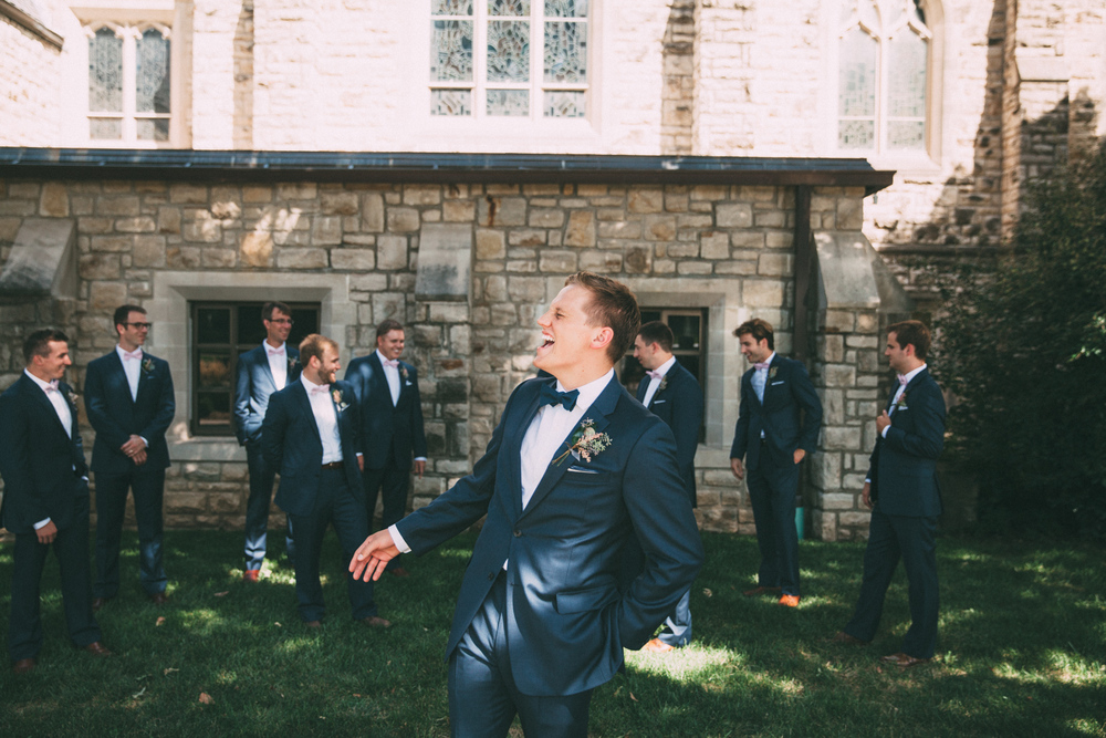 Groom laughing at groomsmen