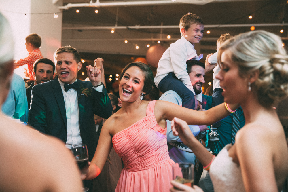 Maid of honor dancing at a wedding reception in Kansas City