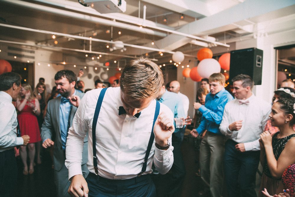 Groom dancing at his wedding reception in Kansas City