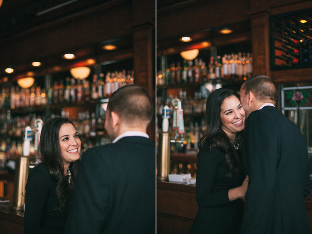 Engaged couple laughing at the bar