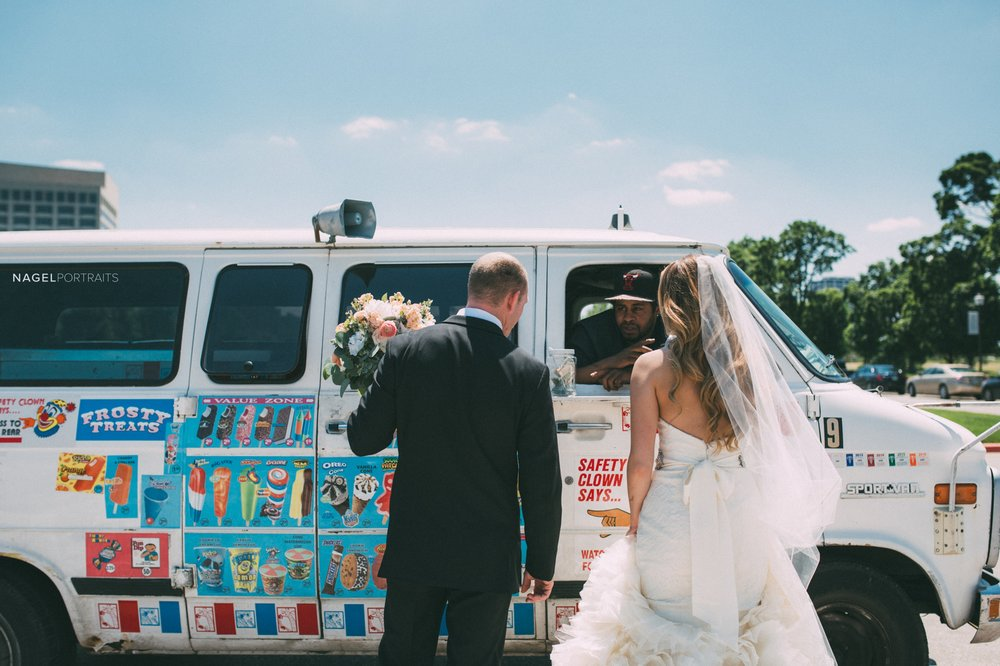 bride and groom stop for a treat at an ice cream truck on their wedding day in kansas city